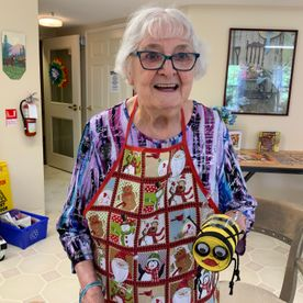old lady holding a bee